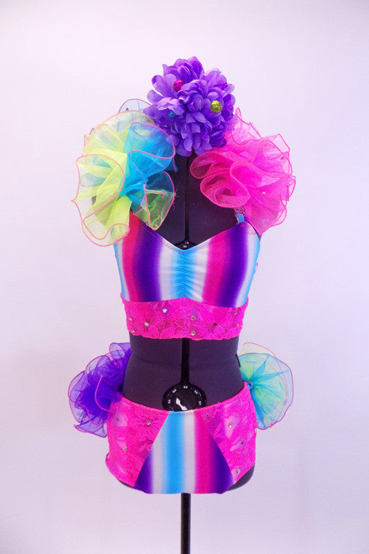 Neon 2-piece costume is striped pink, blue & purple with pink crystaled lace & large crystal brooch accent. Rainbow curly organza lines halter collar & back. Comes with floral hair accessory. Front