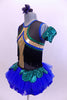 Tank leotard dress has blue, green & gold piping, black fringe from  bust to back & a blue tutu skirt with green scales accents. Has gauntlet and hair accessory. Side