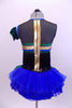 Tank leotard dress has blue, green & gold piping, black fringe from  bust to back & a blue tutu skirt with green scales accents. Has gauntlet and hair accessory. Back