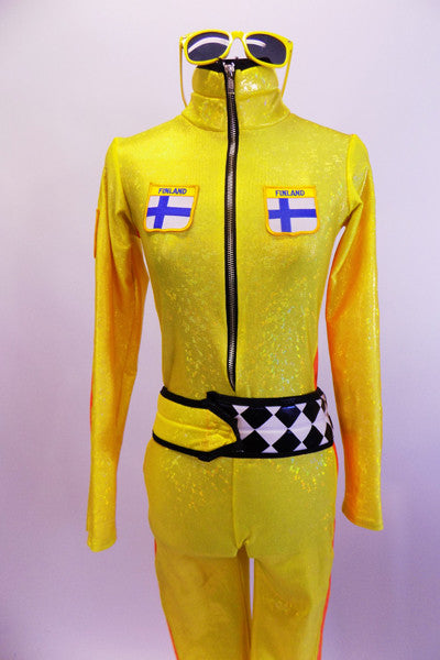 Yellow zip front full unitard has Finish emblems on front bodice. Sides have bright orange racing stripes & belt is black/white checkered. Comes with sunglasses. Front