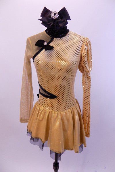 Gold long sleeved dress had one pouf & one sheer gold mesh sleeve & shoulder. Oriental style collar & piping. Has large black bow on back & black hair bow. Front