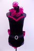 Black high neck halter leotard has collar of hot pink sequined roses. There is a large pink bow on behind. Has longs black gloves and matching hair accessory. Front