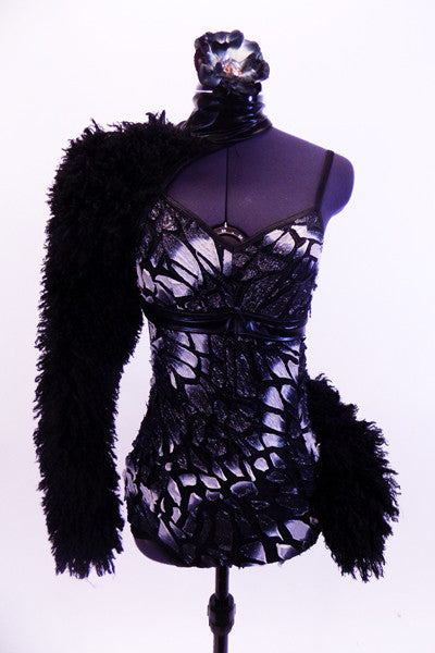 Leotard with silver mosaic butterfly pattern and black leather trim. Right arm, shoulder and left hip accent are black curly fur, Has matching hair accessory. Front