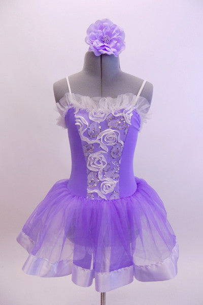 Pale lavender leotard dress has white ribbon rose detailed front bodice. The attached skirt is lavender organza that sits on layers of white tulle.  Comes with matching hair accessory. Front