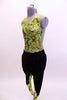 Neon green, open backed leotard with black splatter pattern has black hip-hop harem pants with matching green pattern on lower leg.  Comes with hair accessory. Side