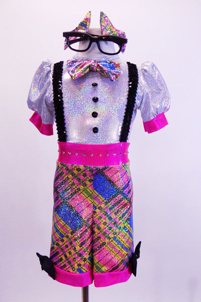 Brightly coloured iridescent tartan short unitard with crystal accented waistband has attached sequined suspenders, buttons and bow tie. Comes with large geek glasses, and bow hair accessories.   Front