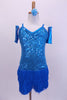 Camisole style turquoise sequined flapper dress has layers of blue fringe attached at hip. Comes with wrist gauntlets and a matching floral hair accessory. Front