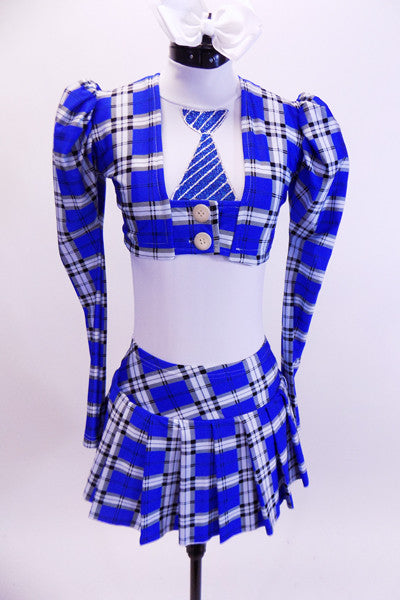 Three piece costume comes with white halter leotard with painted tie, blue-white-black tartan pleated skirt and pouf-sleeved blazer. Comes with white hair bow. Front