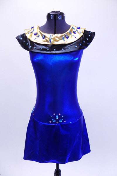 Electric blue halter leotard dress has attached Egyptian style gold and black, jewel/crystal covered collar . There are also jewels and Swarovski crystals at front and sides of waistline. Dress has an open back, attached box skirt and large gold sequined applique at lower back. Front