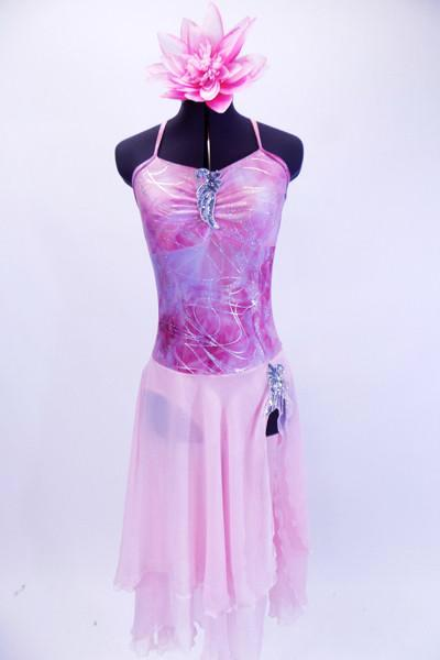 Pale pink chiffon skirt is attaches to a criss-cross strap low back leotard. The leotard has a marble like print with silver swirls and silver applique accents at bust and left hip. Comes with large waterlily hair accessory. Front