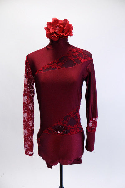 Deep red short unitard has high collar and long sleeves. The entire back and right sleeve is comprised of floral lace with matching insert lace panels at left shoulder, left hip and left wrist. Comes with deep red matching rose hair accessory. Front
