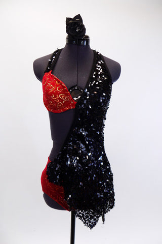 Red velvet halter bra and matching brief has inlaid gold swirl patterns and a black sequin covered shawl-like half-dress that originates from the left shoulder, wrapping around bust to the right hip. The open back has three nude coloured straps to hold the bra in place. (32A). Comes with matching hair accessory. Front