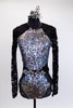 Long sleeved leotard has lace back and sleeves. The brief portion is silver with a black mesh overlay. The front of the leotard is covered in iridescent sequins and has a large jeweled belt which snaps at the back. Comes with a silver and black hair accessory. Front