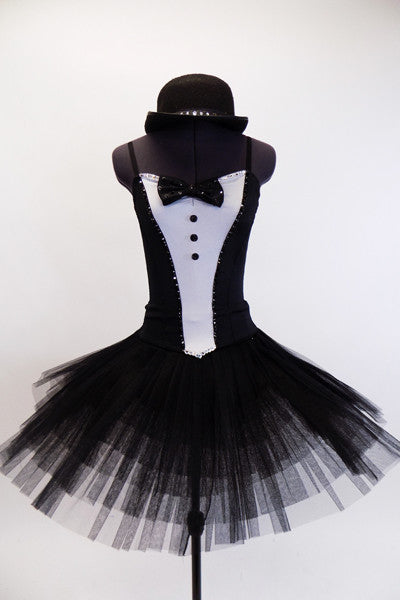 pleated, tacked tutu with ruffled panty. The Costume is completed with a black bowler hat with crystal accents. Front