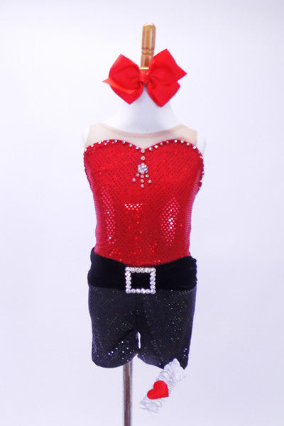 Red sparkle leotard with crystaled sweetheart neckline &clear mesh shoulders, has matching black sparkle shorts with crystal buckle accent, garter and hair bow. Front