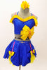 Blue bra top with yellow ruffle & large bow accent. The matching skirt is a blue overlay with  of yellow  petticoat & bows accents. Has floral hair accessory. Front