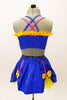 Blue bra top with yellow ruffle & large bow accent. The matching skirt is a blue overlay with  of yellow  petticoat & bows accents. Has floral hair accessory. Back