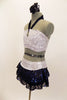 White & silver sequin bandeau bra top has front loop with navy halter collar. The briefs are separate from navy sequined lace skirt. Comes with hair accessory. Side
