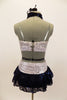 White & silver sequin bandeau bra top has front loop with navy halter collar. The briefs are separate from navy sequined lace skirt. Comes with hair accessory. Back