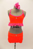 Bright neon orange/coral velvet 2 piece costume has bright pink sparkle ruffle along base of the top. The shorts have crystal accents. Very bright on stage. Comes with pink hair accessory. Front