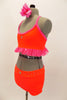 Bright neon orange/coral velvet 2 piece costume has bright pink sparkle ruffle along base of the top. The shorts have crystal accents. Very bright on stage. Comes with pink hair accessory. Side