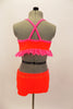 Bright neon orange/coral velvet 2 piece costume has bright pink sparkle ruffle along base of the top. The shorts have crystal accents. Very bright on stage. Comes with pink hair accessory. Back