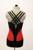 Unique leotard is black sparkle extending down  front center, brief area & mid back. The sides are red mesh & straps cross at back.Comes with hair accessory. Back