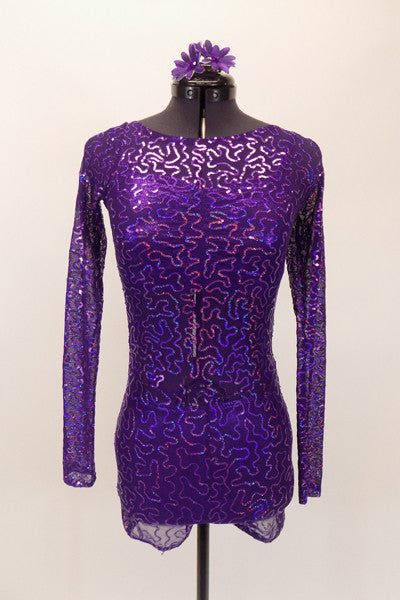 The three piece costume consists of a purple sheer sequined leotard that covers a purple metallic bra top and matching briefs. Comes with hair accessory. Front