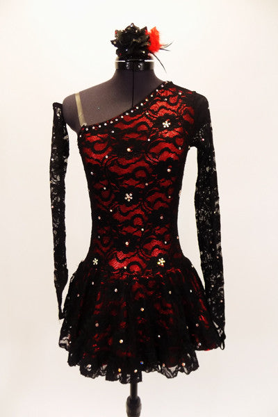 Red shimmery base one shoulder dress has  gathered skirt and black lace overlay with Swarovski accents throughout. The single sleeve and long gauntlet are both sheer black lace and accented with crystals. Comes with a matching red and black hair accessory Front
