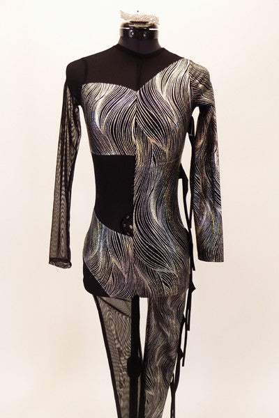 Black and silver full unitard has alternating sections of sheer black mesh and silver swirl pattern. Right arm and leg are both sheer mesh and left side has mesh fabric fringe accents. Front