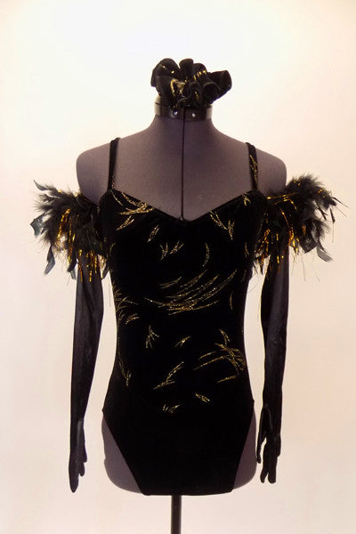Black velvet high-cut leotard has gold glitter streaks throughout. The back has criss-cross straps and a low mid-back. Comes with long black gloves that have matching gold and black feather accent. Comes with matching hair accessory. Front
