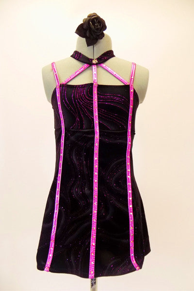 Black swirl velvet, A-line baby-doll dress has attached panty, and crystal lined vertical pink accents. The pink stripe accents come together at the velvet choker collar. Comes with hair accessory. Front