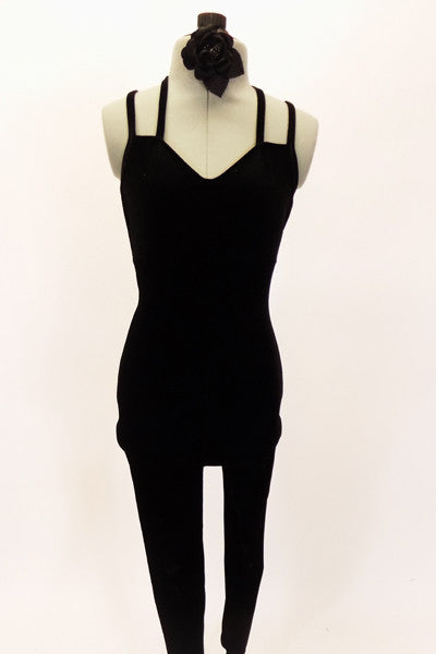 Black velvet full unitard has low back with double criss-cross straps. Comes with black floral hair accessory. Front