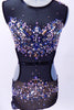 Black mesh leotard with open sides and back is lined with nude lycra in brief area. The costume is extensively covered with jewels, Swarovski crystals and metal studs along the bodice and hips.  Comes with metallic jewel hair accessory. Front  zoom