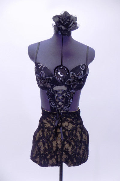 Black sequined lace bra  is attached to black, lined, high waisted short with marching V-shaped corset accent. Comes with matching hair accessory. Front