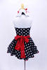 Halter style, black & white polk-a-dot leotard with white sparkle collar, has matching skirt with petticoat. Comes with a white sequined apron with red heart and large red hair accessory. Back