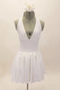 White, halter leotard dress has cross straps, low back & waistband separating the bust area & gathered skirt with tulle. Comes with floral hair accessory. Front