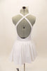 White, halter leotard dress has cross straps, low back & waistband separating the bust area & gathered skirt with tulle. Comes with floral hair accessory.Back