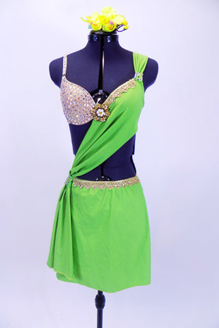 Apple green sarong dress over nude bra (34B) covered in Swarovski crystals has gold lace edging & large golden broach. Comes with green orchid hair accessory. Front