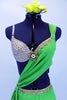 Apple green sarong dress over nude bra (34B) covered in Swarovski crystals has gold lace edging & large golden broach. Comes with green orchid hair accessory. Front zoomed