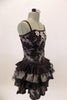 Black boned corset dress has grommet and ribbon lace back & silver floral lace overlay with jewel accents. The skirt is layers of pleated black & silver satin. Comes with hair accessory. Right side