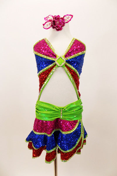 Pink, blue & red sequined dress has layered skirt, angled bust & open front torso. The bright green piping and waist is covered with hundreds of AB crystals. Has sequined hair accessory. Front