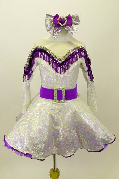 Silver dress has long sleeves and nude mesh upper. The bust-line is decorated with silver sequined, purple and white fringe. The dress has a wide purple belt with matching purple petticoat. Costume comes with silver and purple hair accessory. Front
