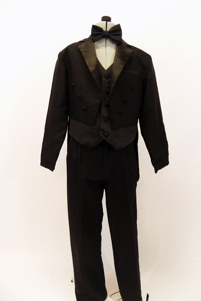 Three piece black evening tailcoat suit has  high waisted satin lapelled coat,over a black satin vest & pleated pants with satin stripe. Comes with bow tie. Front