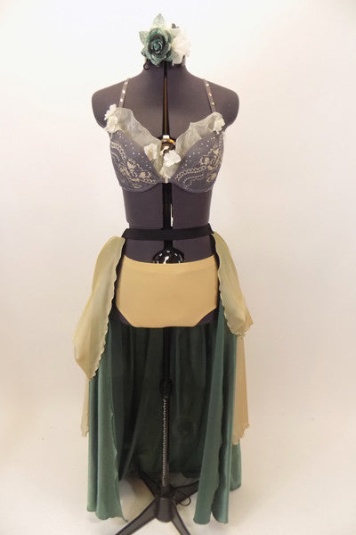 Long green and cream open-front skirt has ruched pick-ups on chiffon layer. Comes with nude brief & grey- cream lace bra with organza ruffle & hair accessory. Front