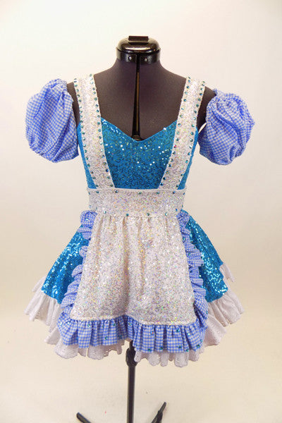 Blue sequined leotard dress has white top and separate pull-on checkered poufy sleeves. Comes with sequined white apron with blue checkered ruffles. Front