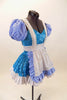 Blue sequined leotard dress has white top and separate pull-on checkered poufy sleeves. Comes with sequined white apron with blue checkered ruffles. Right side