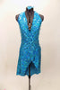 Bright aqua, fully sequined halter dress, has cross-over bodice as well as cross-over skirt with peek-a-boo front.  Comes with applique hair accessory.  Front