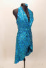 Bright aqua, fully sequined halter dress, has cross-over bodice as well as cross-over skirt with peek-a-boo front.  Comes with applique hair accessory.  Right side