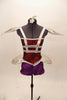 Red & purple short unitard has silver cage-like crystaled strap accents on torso that double as straps. Shoulders & hips have silver padded, embellishments. Front